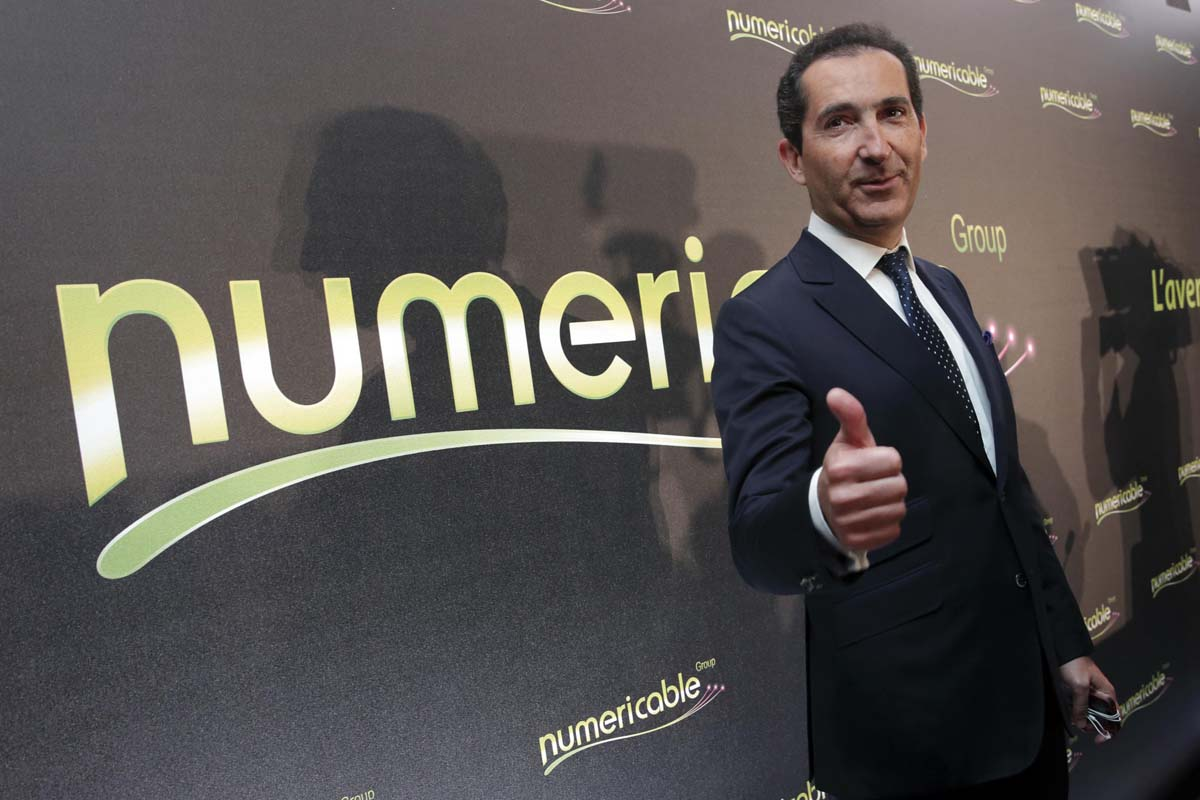 Patrick Drahi, Franco-Israeli businessman, Executice Chairman of cable and mobile telecoms company Altice and founder of Numericable, poses prior to a news conference in Paris