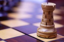 Pièce sur un plateau d'échecs (Tour)